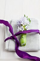 Hyacinth and purple ribbon on linen napkin