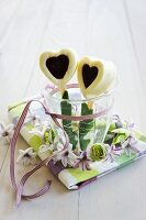 White chocolate and jam hearts in glass surrounded by small spring wreath