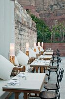 Set, outdoor tables in restaurant of Raas Haveli Hotel, Jodhpur, India