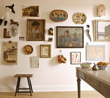 Eclectic gallery of pictures and memorabilia on wall