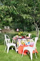Table set with summery tablecloth in garden