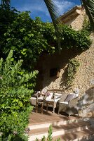 Range of seating on terracotta flooring in Mediterranean courtyard