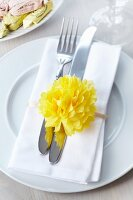 Napkin ring decorated with tissue paper pompom