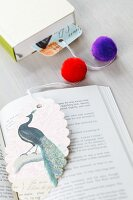 Bookmark decorated with pompoms