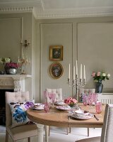 Dining table and upholstered chairs in front of fireplace