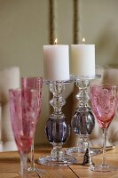 Pink champagne flutes and glass candlesticks