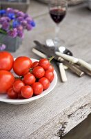 Fresh tomatoes on a wooden table