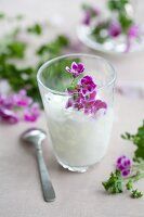 Coconut drink with scented geranium oil & pelargonium flowers