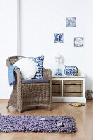 Wicker armchair in front of storage bench with Dutch ornaments and single wall tiles