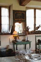 Ornaments and collection of antiques in rustic kitchen-dining room