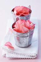 Little metal buckets filled with rose petals