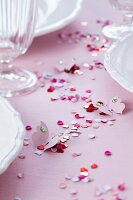 Confetti & paper butterflies decorating table