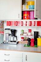 Colourful kitchen utensils in kitchen