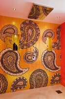 Bathroom wall with gold mosaic tiles and paisley pattern