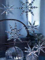 Dangling star-shaped baubles made from silver beads