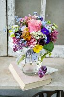 Romantic bouquet with a paper collar in a glass vase