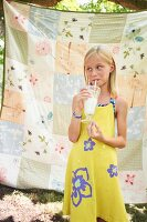 A Young Girl Drinking a Milkshake Outdoors
