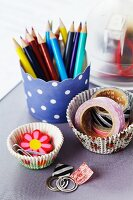 Pens and stationery in paper cake cases
