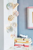 Fairy light lanterns made from paper cake cases