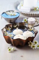 Cake mould used as bowl for floating candles & waxflowers