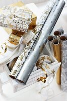 Rolls of festive wrapping paper and ribbons