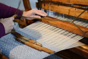 Weaver working on a loom