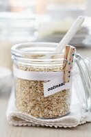 Storage jar of oatmeal & clothes peg holding label