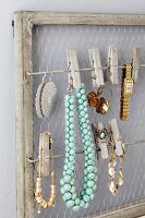 Framed jewellery rack with clothes pegs