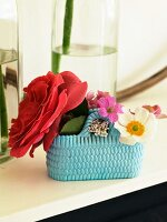 Assorted flowers in a ceramic basket