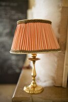 Table lamp on a mantelpiece