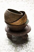 Stacked ceramic and metal bowls used for incense