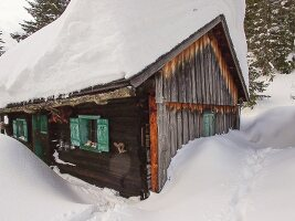 Snow-covered Alpine cabin
