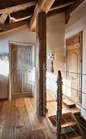 Stairwell in rustic, chalet ambiance with balustrade hand-crafted from posts and rope