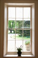 View of summery garden through lattice window
