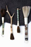 Various paintbrushes on animal skin