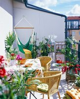 A balcony with furniture and green plants