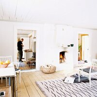 White interior of country house with open fireplace