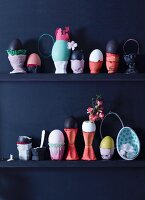 Eggs in decorative egg cups on shelves