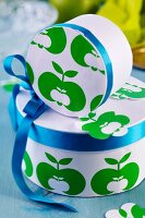 Gift boxes covered in paper with apple motifs