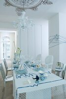 Table festively set in white and blue