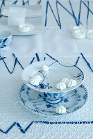 Blue and white bonbon stand made from plates and teacup
