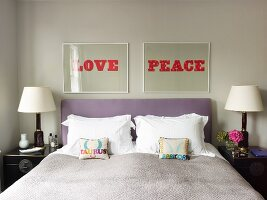 Pictures with words LOVE and PEACE above double bed with lilac headboard and small scatter cushions