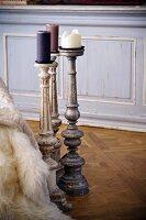 Shabby chic candlesticks on Versailles parquet floor
