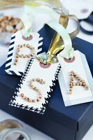 Gift tags with initials made from wooden beads