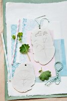 Pendants with impressions of lady's mantle flowers in plaster
