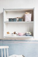 Upcycling - ornaments in painted, shabby-chic shelves on wall in vintage interior