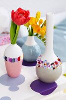 Tulips and freesias in vases decorated with confetti