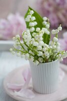 Lily-of-the-valley in white beaker