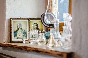 Windowsill decorated with religious icons in country-house style