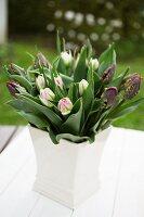 Vase of tulips on garden table